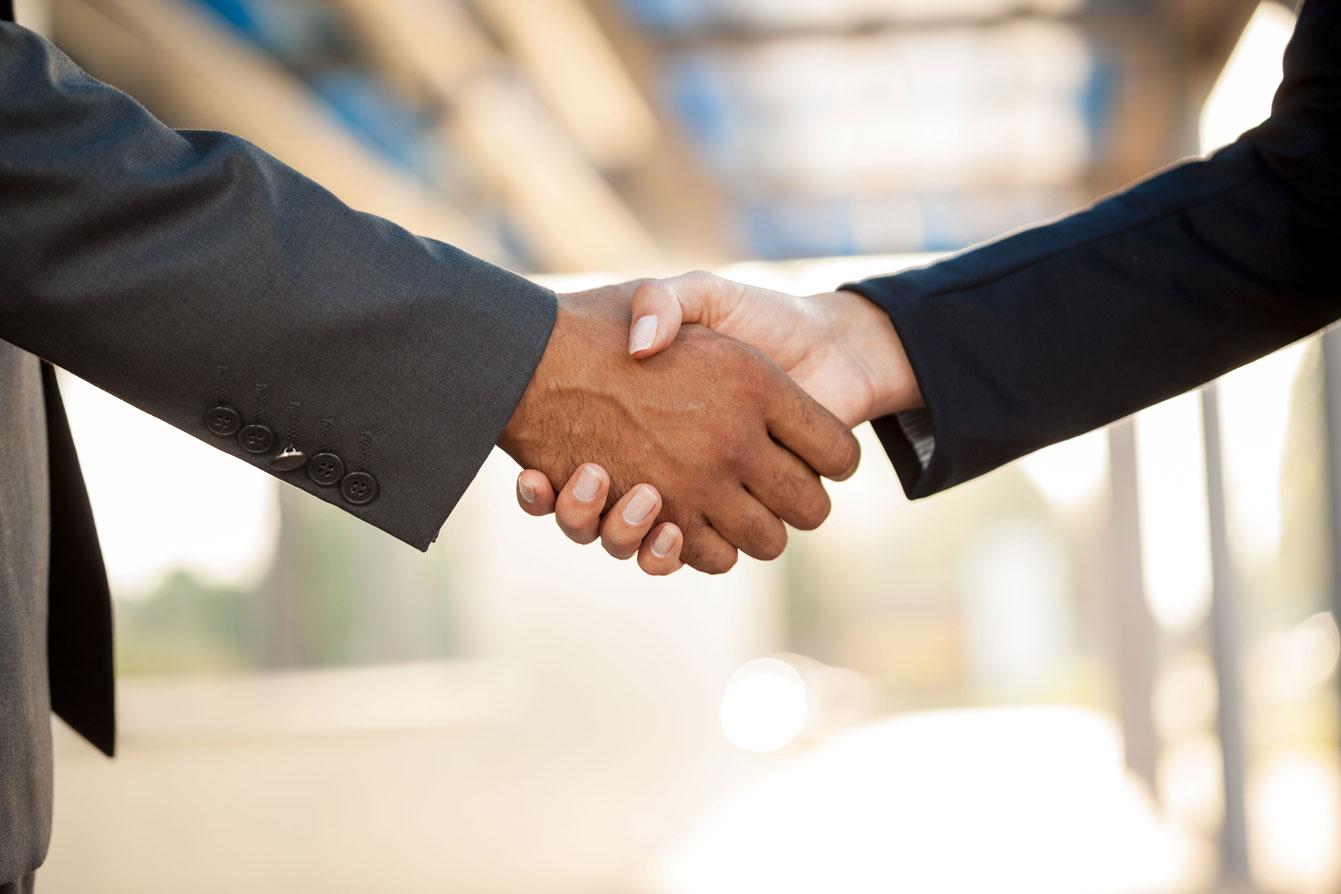 multi-cultural-handshake-business-male-female