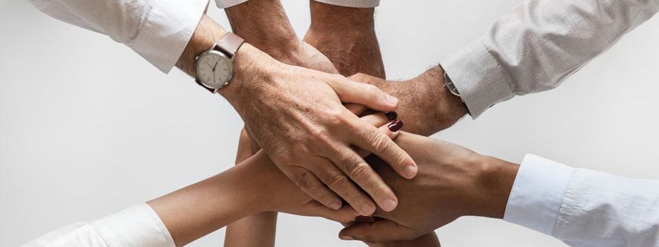 ensure-encounter-success-banner-hands-together-team-business-partners-providers-success-encounter-interpreters