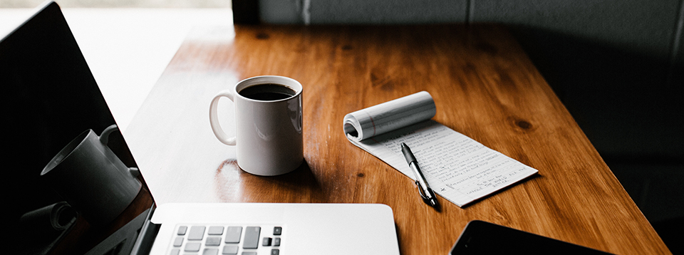 freelancing-language-industry-coffee-computer-pen-note-pad-phone-wood-table-2